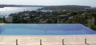 Unobstructed View Of Infinity Pool With Glass Homestead Fencing