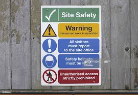 Construction Site Safety Notices On Wooden Fence High Res Stock Photo Getty Images