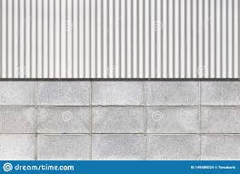 Galvanized Fence And Cement Block Wall Stock Photo Image Of Blue Pattern 149485024