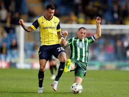 Team-mates: Oxford United winger Marvin Johnson