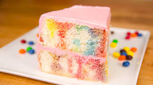 poke cake with skittles ercream