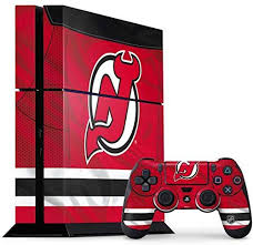 Amazon Com Skinit Decal Gaming Skin Compatible With Ps4 Console And Controller Bundle Officially Licensed Nhl New Jersey Devils Home Jersey Design Electronics