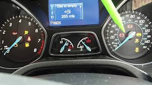 checking dashboard warning lights in