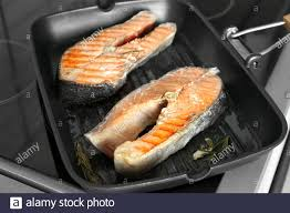 Grill pan with delicious salmon steaks ...