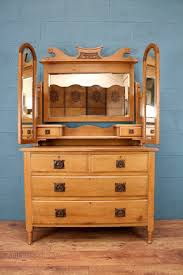 an arts and crafts oak dressing table