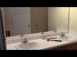how to remove mirror off wallsafely