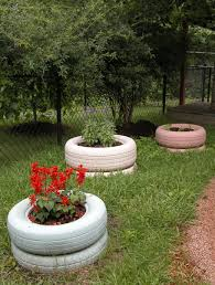Painting Tire Planters Natural Learning Initiative Creative Gardening Tire Planters Tire Garden
