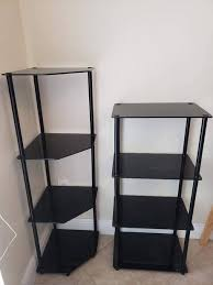 2 black 4 tier tower stands moving