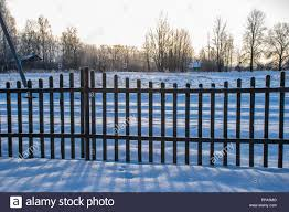 Old Wooden Fence In Garden At Countryside With Morning Light And Snow Around It In Winter Stock Photo Alamy
