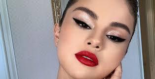 selena gomez debuts hot red lip and