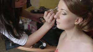 bridal makeup artist applying eyeshadow