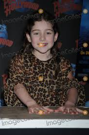 """Photos and Pictures - Actress Rachel Covey poses maked a handprint to  promote the release of """"Enchanted"""" on DVD at Planet Hollywood in Times  Square"""