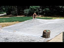 covering the lawn in plastic soil