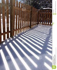Wood Fence Shadow In Snow Stock Photo Image Of Shadows 50764260
