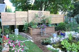 Diy Raised Garden Bed With Built In Privacy Wall Empress Of Dirt