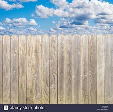 Rustic Whitewashed Wooden Fence With Blue Sky And Clouds Stock Photo Alamy