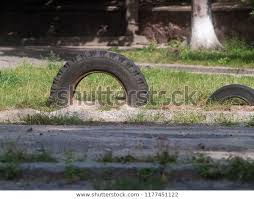 Old Car Tires Dug Into Ground Stock Photo Edit Now 1177451122