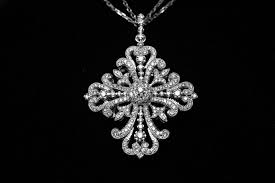 antique style diamond cross pendant and