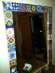 mirror and glued 2x2 talavera tiles