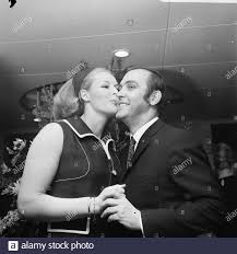 Couturier Edgar Vos shows new collection. Ada Kok with Edgar Fox Date:  March 12, 1969 Keywords: couturiers, fashion Person Name: Cook, Ada, Fox,  Edgar Stock Photo - Alamy