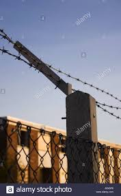 Security Fence Barb Wire Link Chain Pole Bolts Fix Attach Disused Stock Photo Alamy