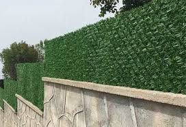 What Are The Distinctive Features Of Artificial Grass Fence Panels