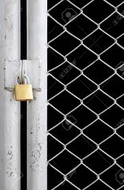 Chain Link Fence And Metal Door With Lock Isolated On Black Stock Photo Picture And Royalty Free Image Image 12457496