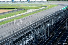 Empty Asphalt Road Circuit And With Safety Fence And Line Mark In Outdoor Circuit Race Track With Curve Road For Car Racing View From Grandstan Buy This Stock Photo And Explore