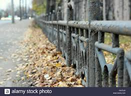 Gray Blue Metal Fence With Peeling Paint In The Long Run As A Stock Photo Alamy