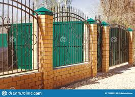 Brick And Metal Fence With Door And Gate Of Modern Style Design Metal Fence Ideas Stock Photo Image Of Green Concrete 133889198