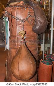 boxer gloves and leather punching bag