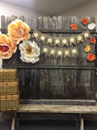 Photo Backdrop For Twins Party Made From Old Fence And Italian Crepe Paper Flowers Photo Booth Backdrop Graduation Graduation Photo Booth Party Photo Backdrop