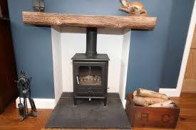 wooden beam above their fireplace