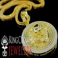 10k yellow gold on silver greek design