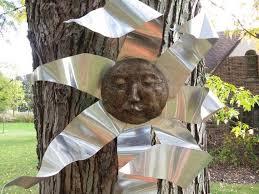 garden sun face hanging sculpture in
