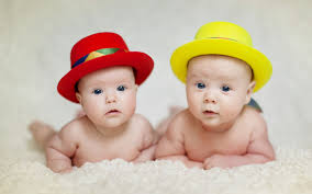 wallpaper of cute twins baby in a hat