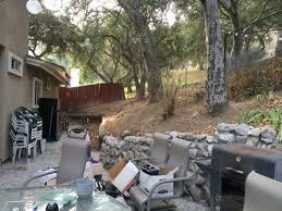 retaining wall next to oak tree what