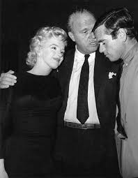Marilyn with director Joshua Logan and Milton Greene at a party ...