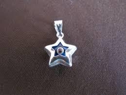 silver star blue evil eye pendant