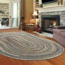 braided rug in front of the fireplace