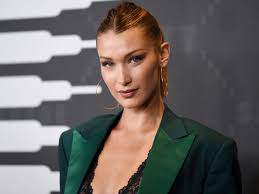 Bella Hadid wears long leather jacket with no shirt underneath - Insider