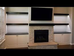 floating shelves and fireplace mantel