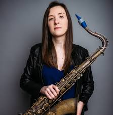 Emma Johnson plays Syos on her tenor saxophone