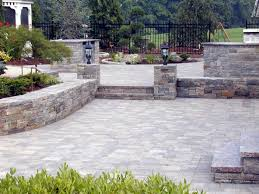 grey paving slabs and garden wall