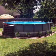 Our Intex Above Ground Pool With Brick Edging Pea Gravel Pots Of Flowers Above Ground Pool Landscaping Backyard Pool Landscaping Above Ground Swimming Pools