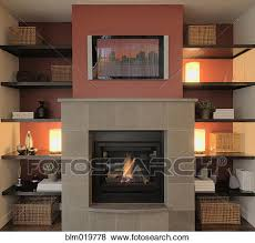 flat screen tv above the mantle