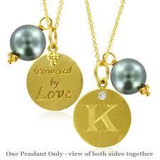 pearl charm letter k diamond pendant