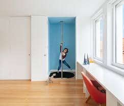 A Fire Pole Hidden Behind A Door Creates A Unique Way To Travel Between Floors