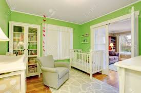 Kids Room In White And Green Tones With Beige Armchair And Rug Stock Photo Picture And Royalty Free Image Image 61646700
