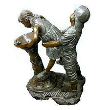 sitting bench reading bronze boy and